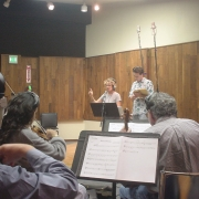 Conducting the orchestra. Photo by Rudy Guess
