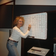 Updating a track on the production board. Photo by Rudy Guess