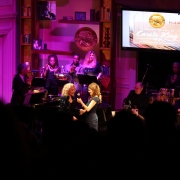 Louise Goffin passes the mic to Carole.  Photo by Elissa Kline